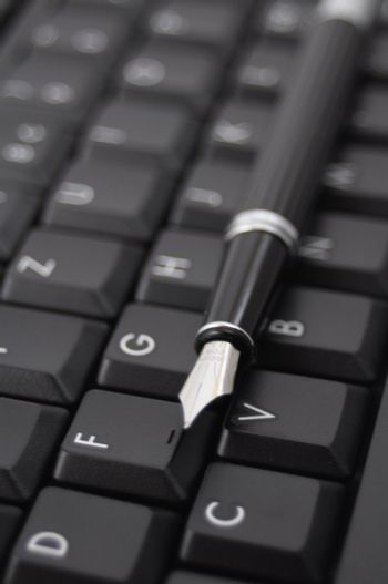 pan and black computer keyboard showing communication concept