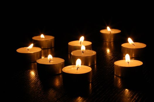 romantic hot candle light on black background