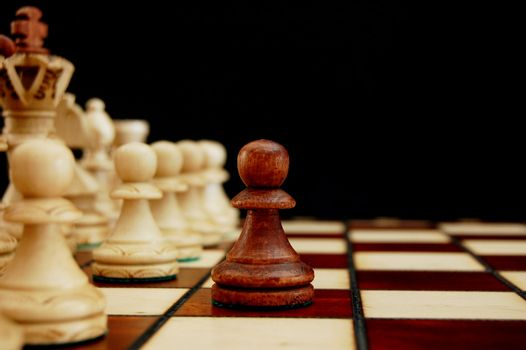 chess pieces showing concept of conflict power and success