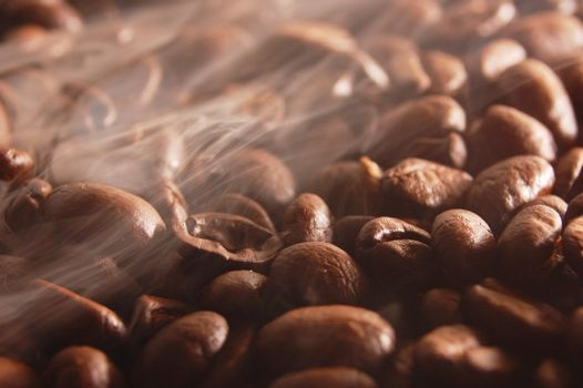 roasting coffee beans with steam and smoke