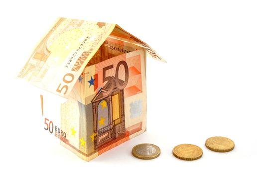 house made of euro money bils isolated on white background