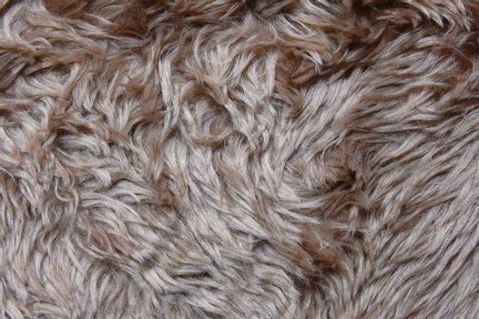 brown cuddly fur textile texture which can be used as background