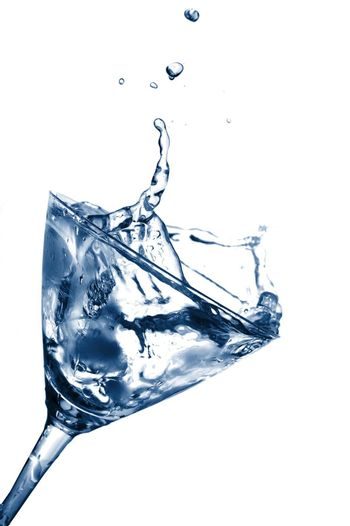 glass of water as a summer drink with ice cube
