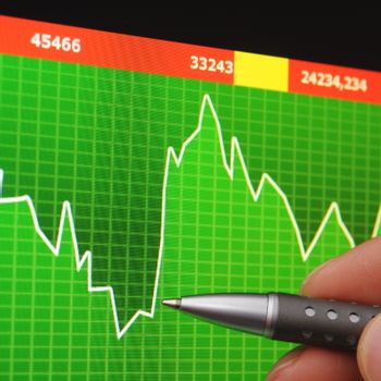 stock index on computer screen an hand
