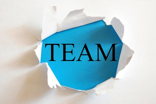 teamwork concept with a hole in white paper