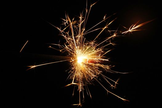 holiday sparkler isolated on black background with copyspace