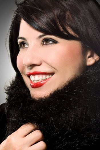 Winter warmth - smiling alluring woman