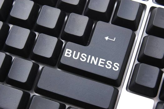 computer keyboard with business enter button in black