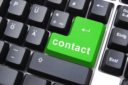 contact text written on a computer keyboard