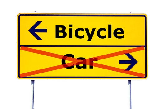 ecology concept with car and bicycle on yellow road sign