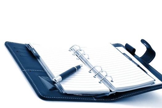 empty business notebook or organizer with pen