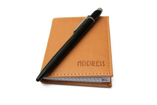 Pen and address book isolated