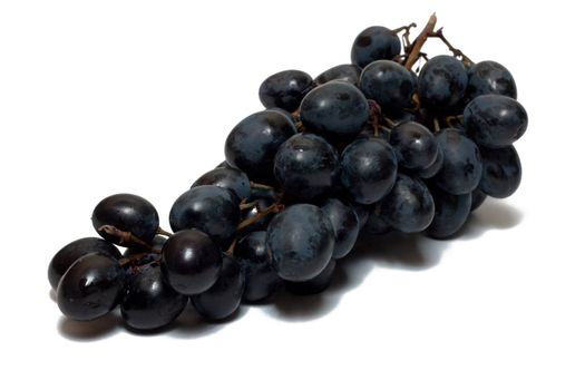 Bunch of grapes of red wine isolated on white