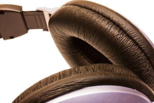 Close up image. Soft black pad of headphones isolated on white.