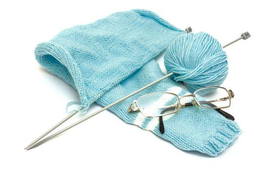 Woollen clothes in perspective and hank of woollen yarn