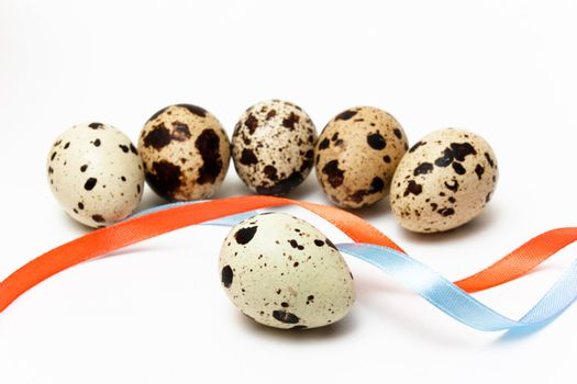 Six quail eggs and two color ribbons