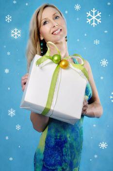 Christmas Seasons Greetings Pretty woman with a present