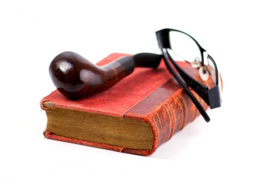 Old folio in dark red cover, pipe and black-rimmed glasses on white background. Book with ancient knowledge.