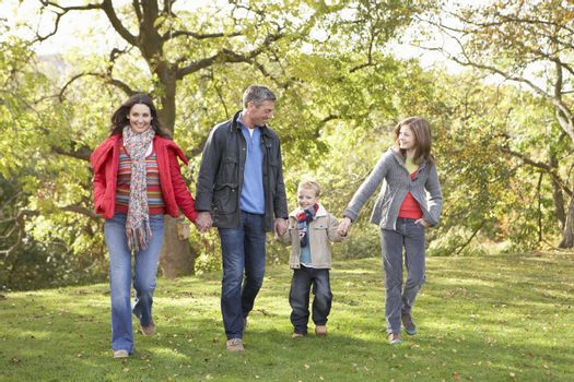 Young Family Outdoors Walking Through Park