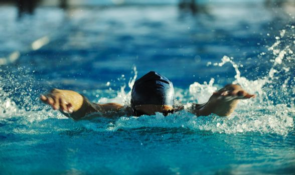 health and fitness lifestyle concept with young athlete swimmer recreating  on olimpic pool