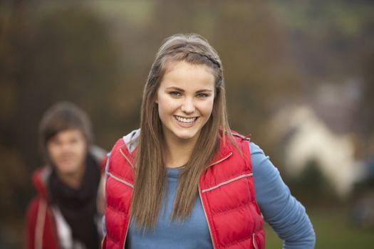 Teenage Girl Outside With Boyfriend In Background