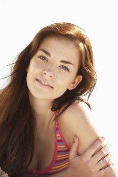 Teenage Girl Relaxing On Beach