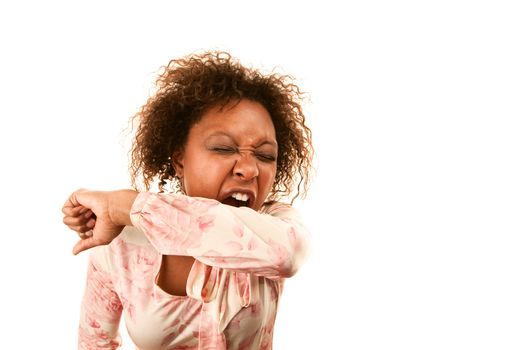Woman sneezing into her sleeve to prevent disease spread