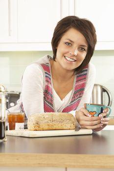 Young Woman Preparing Breakfast In Modern Kitchen