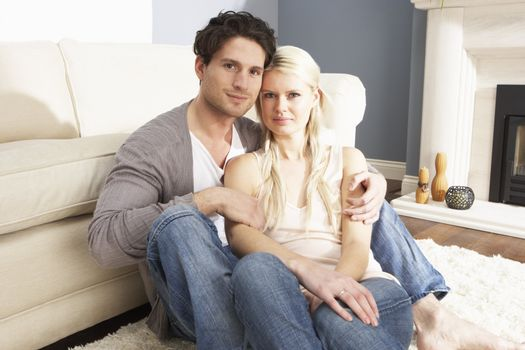 Romantic Young Couple Relaxing Together At Home
