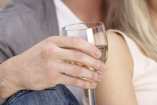 Close Up Of Hand Holding Glass Of White Wine