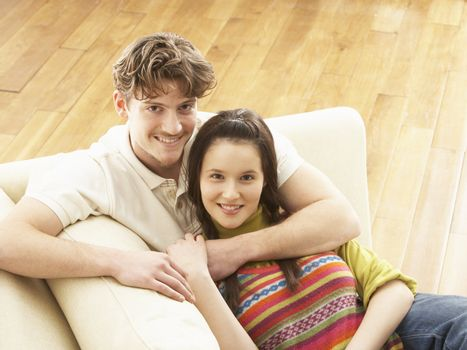 Romantic Young Couple Relaxing Sitting On Sofa