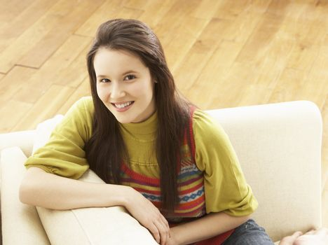 Woman Relaxing On Sofa At Home