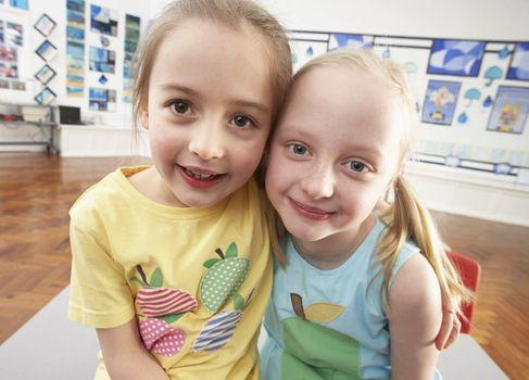 Two Female Primary Schoolchildren In Classroom