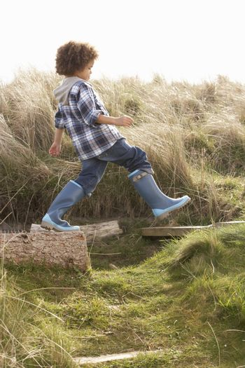 Young Boy Going For Walk In Wellington Boots
