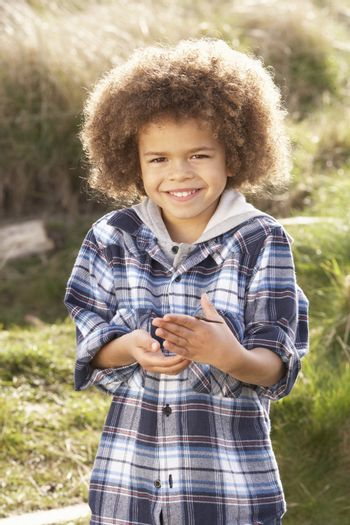 Young Boy Holding Worm Outdoors