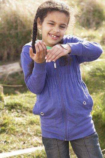 Young Girl Holding Worm Outdoors