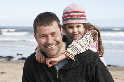 Father And Daughter Having Fun On Beach Together