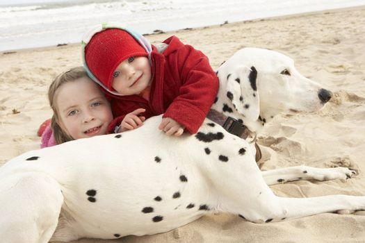 Two Girls On Beach With Pet Dog
