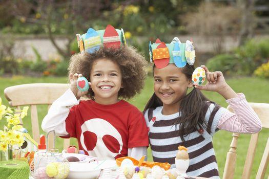 Children Painting Easter Eggs In Gardens