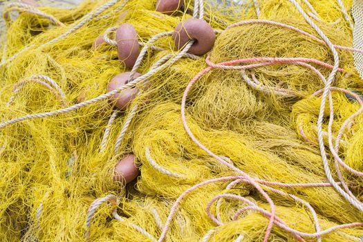 Tangled nylon yellow  fishing tackle close-up: net, float, cord