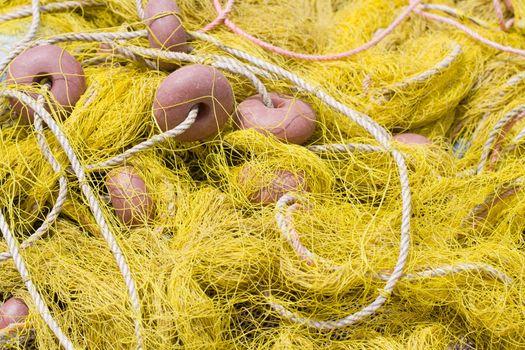 Tangled nylon yellow, fishing tackle close-up: net, float, cord