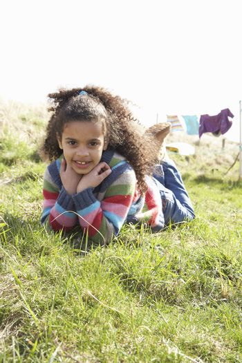 Young Girl Sitting Outside In Caravan Park