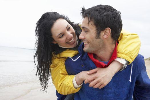 Happy couple on beach in love