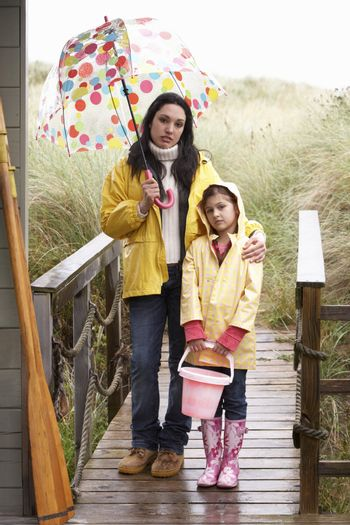 Mother and daughter with umbrella