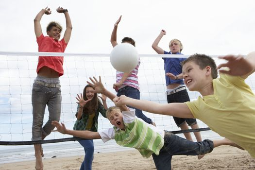 Teenagers playing volleyball