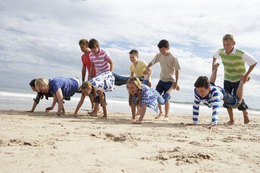 Teenagers playing on beach