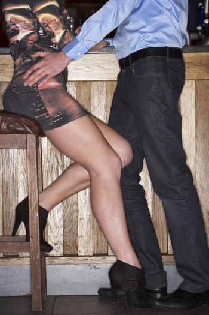 Young couple flirting at bar