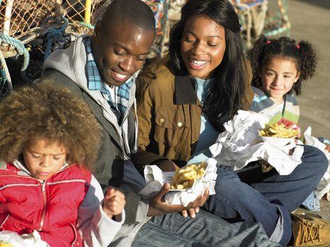 Happy family having picnic