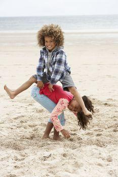 Happy children playing on beach