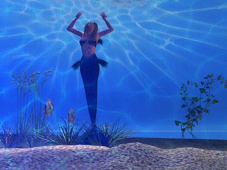 A beautiful mermaid feels the power of light rays coming from the surface of the ocean.